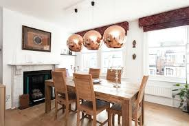 light rustic dining furniture set plus double sided fireplace feat cool copper pendant lights idea