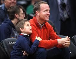 Peyton Manning Peyton Manning And Son Marshall Nongzico