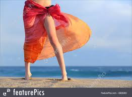 woman legs on vacations posing on the beach with a pareo royalty free stock picture