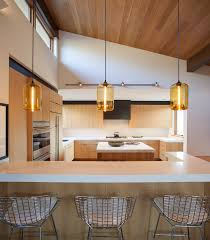 pendant kitchen island lighting. kitchen island pendant lighting emits golden glow in sun valley idaho home