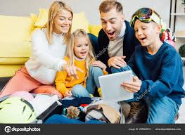 happy family having great time using digital tablet ng winter stock photo
