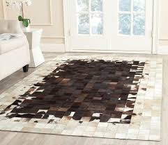 entranching cowhide area rug on ivory chocolate natural patchwork in from