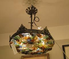 brass and glass flowered ceiling light