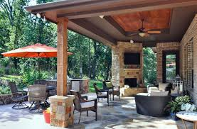 modern outdoor patio with custom stone outdoor fireplace