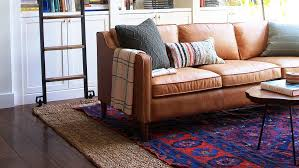 designer jenny komenda s living room where a red and blue statement rug inspired the rest of