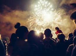 a family at a fireworks display for bonfire night