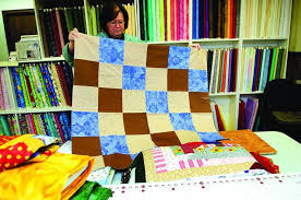 Piece offerings: Quaint Rock Falls quilt shop also home to ... & Linda Bushman, owner of Quilt Supplies for U, displays a quilt that will be Adamdwight.com