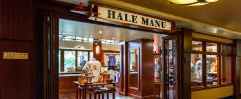 the wood paneled exterior of hale manu boutique with displays of resort wear and