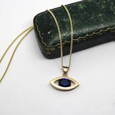 9ct gold handmade evil eye necklace set with a blue spinel bespoke handmade jewellery