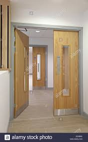 modern office doors. stock photo modern office corridor showing oakfinish double fire doors leading to stairs s
