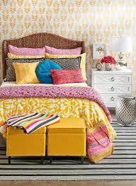 bright colorful bedroom with yellow ottomans
