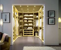 image of luxurious small walk in closet with recessed ceiling