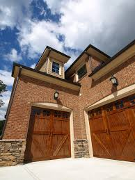 double carriage garage doors. This Brick Home Features Unique Garage With Doors Facing Two Angles Of A Corner: Single Double Carriage O