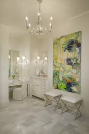master bathroom with visual comfort lighting george ii chandelier and abstract canvas art over modern polished nickel x base bathroom ottomans