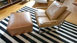 leather chair on black white striped area rug rugs 5x8 how choose best any