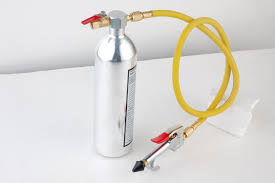 Refillable compressed air canister
