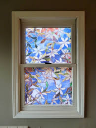 the previous owners used this faux stained glass vinyl to cover up one of the windows in the master bathroom to be honest when we toured the house i was