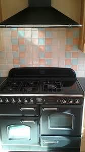 rangemaster stove hood wooden kitchen units including granite sink surround