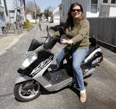 electric bicycle or moped woman caught between ocean city police