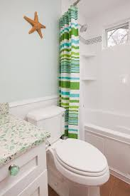 sea glass art ideas with beach style bathroom and beadboard coastal glass countertops glass knobs mosaic tile recycled glass shower tub striped shower