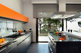 Orange Accents Kitchen Design With Glossy Black Cabinets