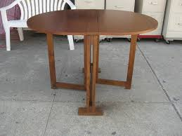 photo of folding round dining table with stunning collapsible dining table on furniture with solid teak