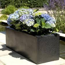 small fibreglass planter on a patio