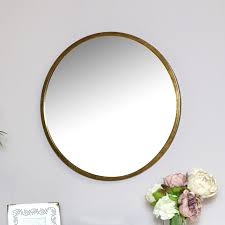 large round gold wall mounted mirror