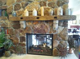 reclaimed mantle with stone corbels