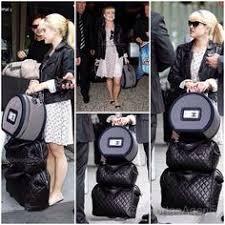 chanel luggage. kelly osbourne wheeling chanel cocoon luggage plus round train case entertainment e! host kelly