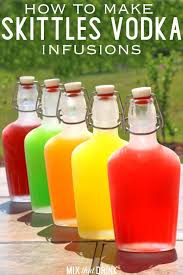 skittles vodka infusions in gl flasks on a patio table