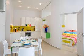 apartment decor diy. Creamy Wall Color Paint Theme Combine Diy Apartment Decor Ideas Endearing Grey Fabric Sectional Sofa Mini Venetian Window Curtain Laminated Red C