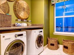 Eclectic Laundry Room With Rattan Basket Wall Art, Laminate Countertop,  Concrete Tile, Window
