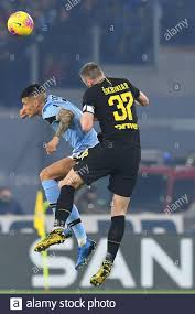 Rome, Italy. 16th Feb, 2020. Carlos Joaquin Correa (Lazio) Milan Skriniar  (Inter) during the Italian Serie A match between Lazio 2-1 at Olimpic  Stadium on February 16, 2020 in Roma, Italy. Credit: