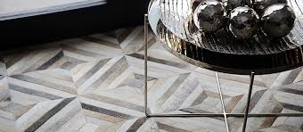 patchwork cowhide rug in taupe diamond design