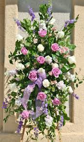 lavender roses and white roses in a standing spray by your local riverside ca florist