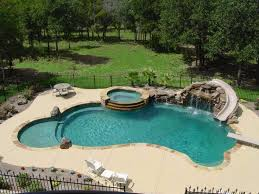 Outdoor pool with slide Mediterranean Swimming Pool Slide Diving Board Hot Tub And Waterfall What More Could You Want Picmia Pinterest Swimming Pool Slide Diving Board Hot Tub And Waterfall What
