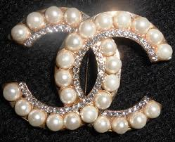 chanel jewelry. symbolic vintage brooch with coco chanel logo cc jewelry h