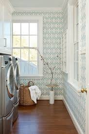 white and blue laundry room with silver washer and dryer