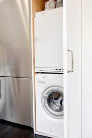kitchen cabinet with stacked washer and dryer