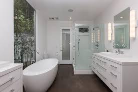 large frameless mirror. Bathroom Concrete Floor Finishes With Large Frameless Mirror And Two Led Wall Sconces Above Mounted Vanity Plus Freestanding Bathtub