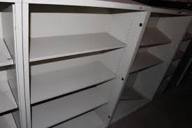 2 metal bookshelves 1 bookshelf w sliding glass doors cur 2