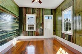 The brown-green reclaimed wood scheme seen in this room actually pervades  the entire house. (Photo via Realtor)