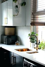 gold kitchen accessories black and gold kitchen kitchen with black cupboards with white open shelving marble tiles gold sink rose gold kitchen accessories