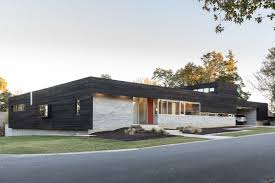 modern house.  House The Modern House Is Covered By Wood Siding And Concrete Brick In Modern House