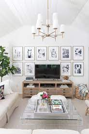 As you start browsing furniture, decorating and wall ideas for your room, think about the space's desired purpose and focus on a few staple items, such as a comfortable sofa and a coffee table, then choose the rest of the accent furniture and wall decor accordingly. 6 Living Room Wall Decor Ideas Say Goodbye To Those Bare Walls Driven By Decor Wall Decor Living Room Family Room Walls Living Room Wall