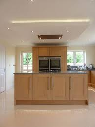 suspended kitchen lighting. Suspended Ceiling With Lights And Flat Extractor Hood Over Kitchen Island Lighting O