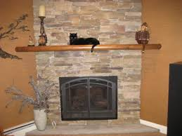 chic stacked stone fireplace with fireplace mantel shelf and fireplace screen for living room ideas