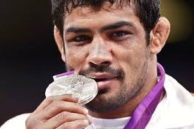 Reuters: Kumar posed with his silver medal in London, Sunday. Click here to view related slideshow. Sushil Kumar missed out on what would have been India's ... - OB-UD469_skumar_E_20120812094357
