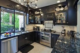 black cabinets with black granite countertops